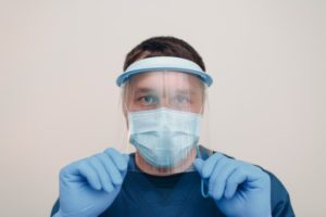 Dentist in Greensboro wearing face shield